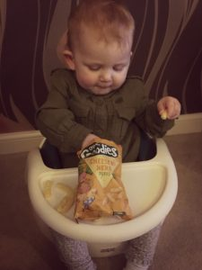 munching her way through Organix cheese puffs
