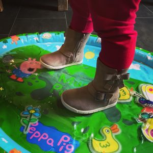 Peppa pig jumping up and down in muddy puddles