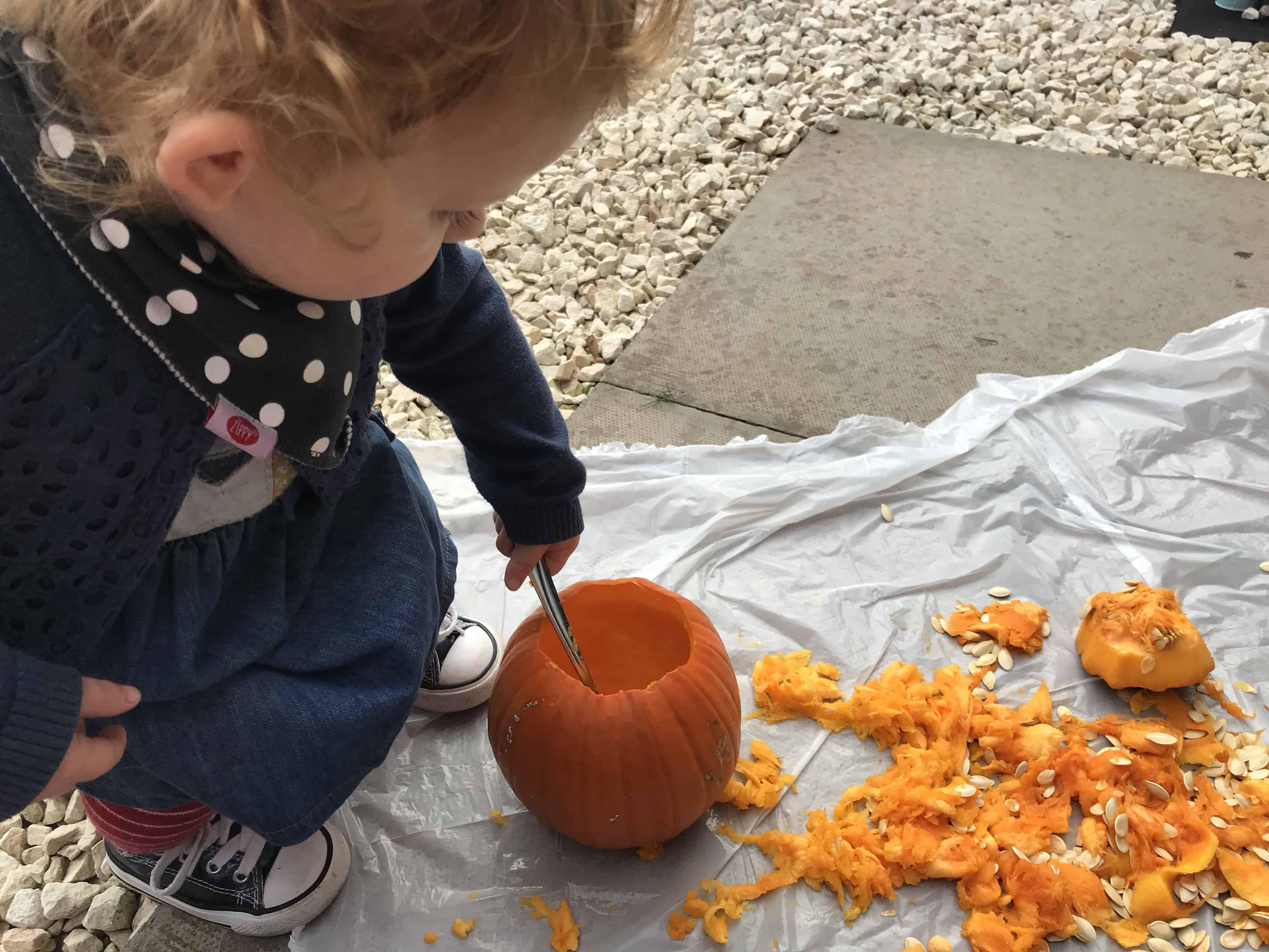 Toddler fun carving pumpkins