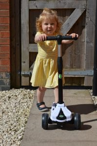 Ava having fun on her Xootz LED tri scooter