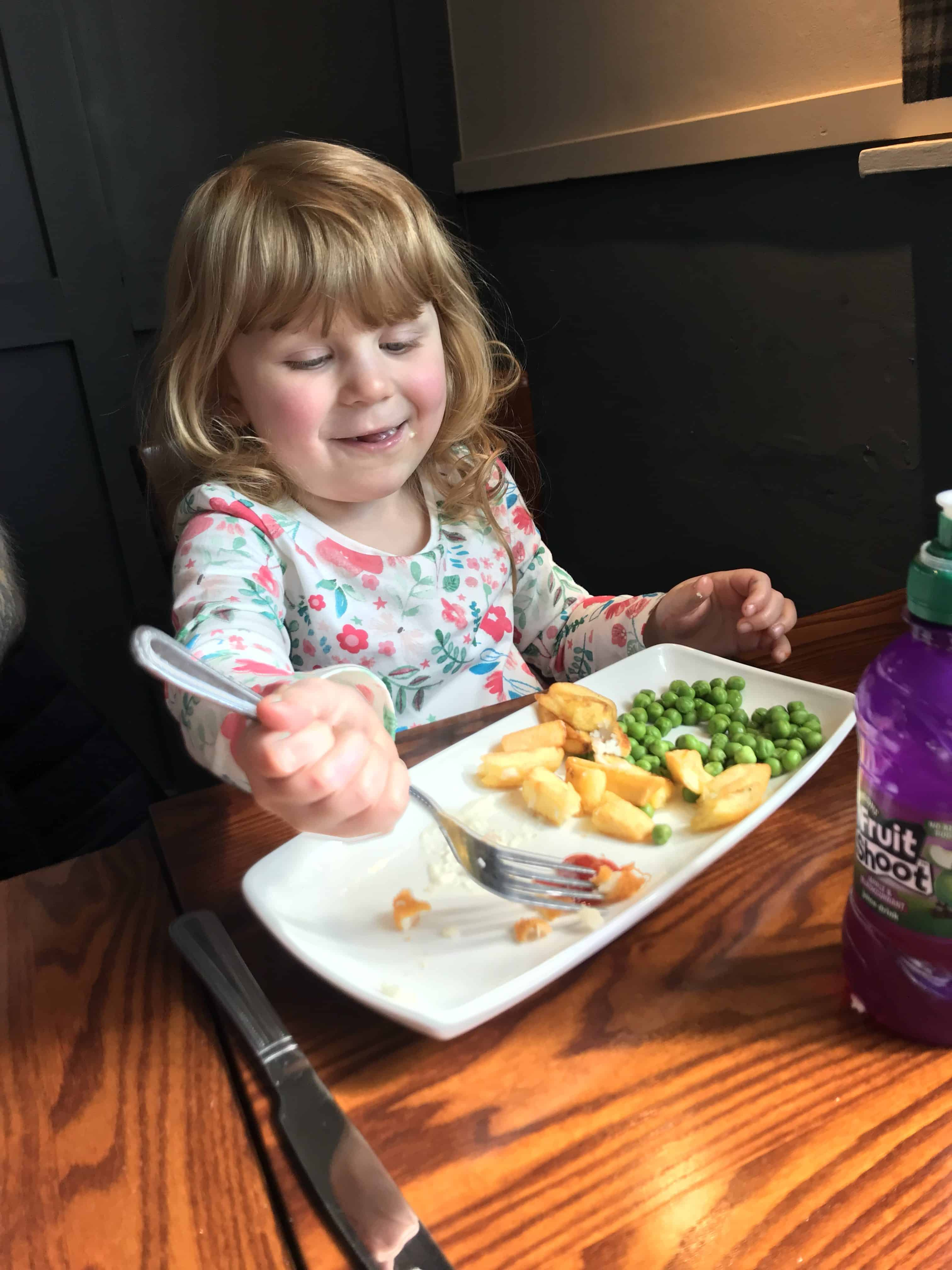 Children's fish fingers, chips and peas