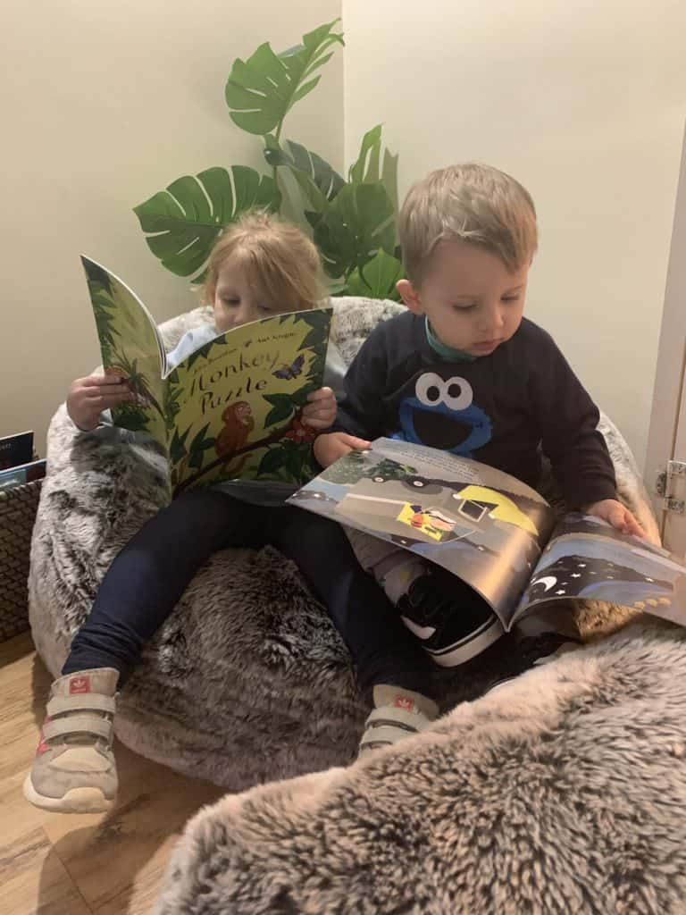 Enjoying their reading snug